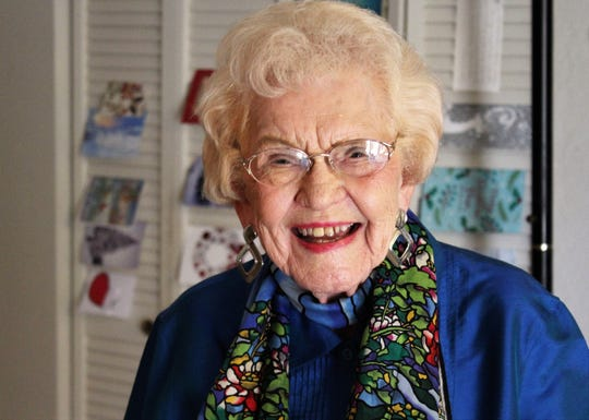 Eloise Carruthers flashes a smile 103 years in the making Friday at her home. Birthday cards filled a table and were placed on walls, and phone calls from well-wishers were constant. An Abilene Christian College graduate, she has lived in the Abilene for the past 25 years.
