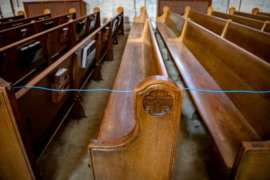 An ethernet cable runs along the empty pews to the altar at the Basilica of St. Lawrence in downtown Asheville allowing the priest to livestream mass on April, 9, 2020. For the first time in the history of the Diocese of Charlotte all of its churches are closed to the public for Holy Week and Easter due to the coronavirus pandemic. St. Lawrence, as well as other churches in the diocese, are live-streaming their masses including the Passion liturgy and Easter service.