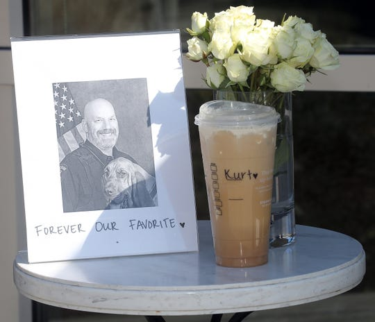 A small tribute to BIPD Officer Kurt Enget outside of the Starbucks on Bainbridge Island on Friday, April 10, 2020.