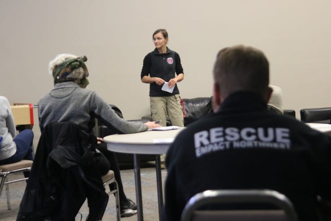Olivia Weeks, an ER nurse with Empact Northwest, leads a volunteer training in Poulsbo on April 4. Empact Northwest typically responds to natural disasters around the world. During the COVID-19 pandemic, it has been responding in its hometown.