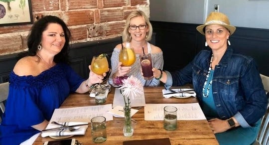 Angela Warwick, left, misses nights out with girlfriends, like this pre-caronavirus dinner with Regina Nuchims and Lisa Davidson at Crush XI in downtown Melbourne.