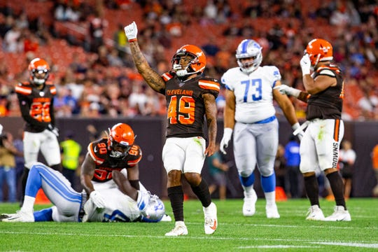JT Hassell, a Florida Tech grad, celebrates after a play during a preseason game against the Detroit Lions on Aug. 29, 2019.