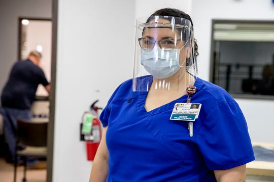 Roxana Reyna, a nurse practitioner at Driscoll Children's Hospital, tries on a face mask being made by Abel Cantu, in the I-Create Lab at Texas A&M University-Corpus Christi on Friday, April 10, 2020. As health care professionals respond to COVID-19, the demand for personal protective equipment has created shortages. The university is working to help meet the need for healthcare workers locally by providing the shields.