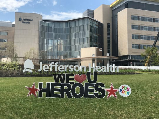 A sign praising healthcare workers popped up outside Jefferson Cherry Hill Hospital on Thursday.