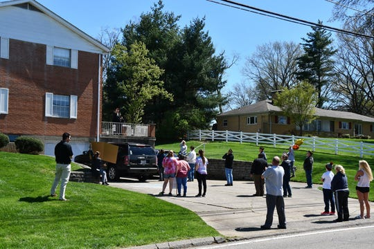With a mind to social distancing, a small group in Green Township gathered Thursday outside World War II Battle of the Bulge veteran Edward Burke's home to wish him a happy birthday.