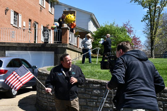 Green Township Trustee Anthony Rosiello holds a microphone as he speaks Thursday, April 9, 2020, outside World War II Battle of the Bulge veteran Edward Burke while wishing him happy birthday.