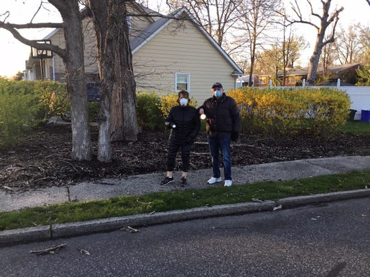 """The Patton Street Neighbors held their first """"Shout Out"""" on Thursdayas they stepped outside in the front of their homes with their flashlights. Wavingthem attheir neighbors on theblock, they did ashout out of""""BeKind, Be Safe""""then went back indoors. The goal was tofeelunitedand knowthat their neighbors were safe during these trying times."""