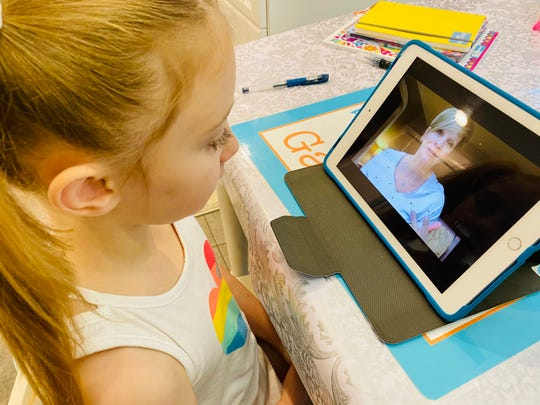 Gabriella Jones of Scotch Plains connects with her Kindergarten teacher, Michele Quinones of Fanwood, during a Distance Learning class meeting.