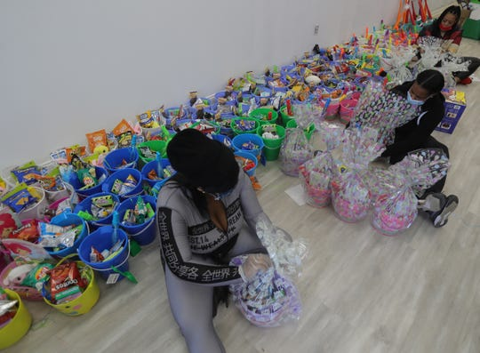 Darylynn Mumphord, Karen Wright and Bonnie Parker make Easter Baskets Friday, April 10, 2020 in Detroit. More than 500 baskets will be made up for kids and handed out on Easter.