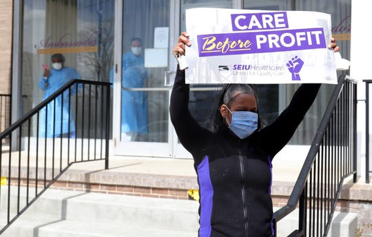 Saran Walker protests along with the SEIU Michigan Healthcare union for working conditions at the Ambassador nursing home on April 9, 2020, in Detroit. Workers at the home were just recently given the necessary PPE needed to treat patients.