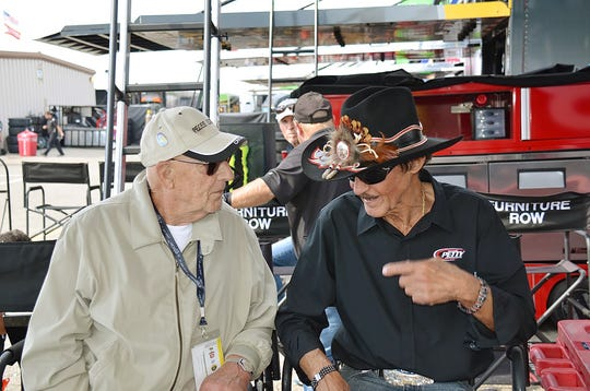 Larry Rathgeb, left, talks with NASCAR legend Richard Petty. Rathgeb was the lead engineer for the car that on March 24, 1970, broke one of racing's most significant milestones, the 200 mph closed-circuit track lap.