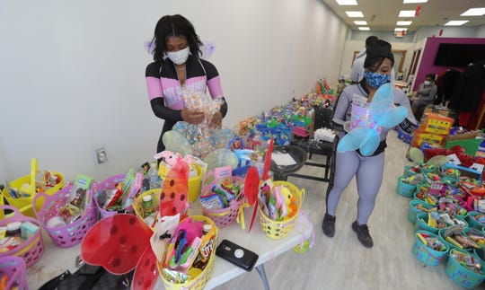 Matashia Dykes a Detroit owner of iBody and Darylynn Mumphord make Easter Baskets Friday, April 10, 2020 in Detroit. More than 500 baskets will be made up for kids and handed out on Easter.