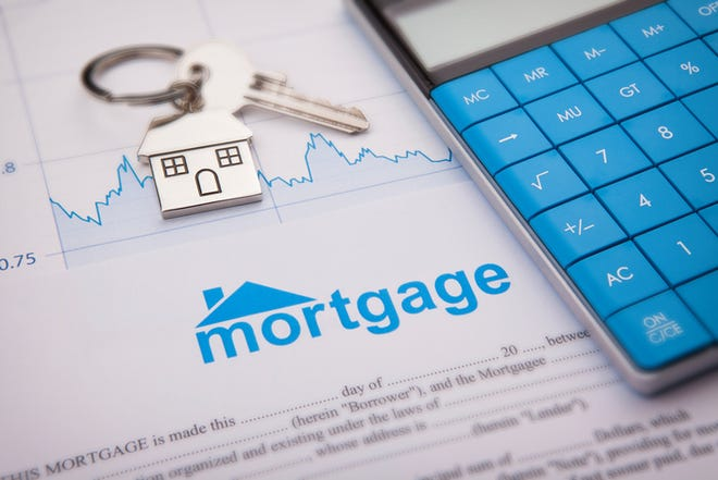 A mortgage application form is shown with a house key and calculator.