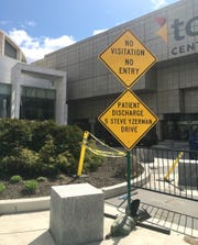 The front of the TCF Regional Health Care Center is barricaded on the first day that coronavirus patients were admitted.