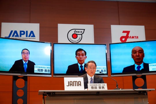 Toyota Chief Executive Akio Toyoda speaks during a video meeting at his office in Nagoya, central Japan, Friday. Toyoda promised Friday the Japanese auto industry would protect jobs, as it braces to overcome the unfolding crisis set off by the coronavirus pandemic.