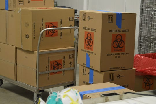 Boxes labeled 'infectious waste' filled with N95 respirator masks from Sparrow Health System arrive at MSU Extension's Food Processing and Innovation Center to be decontaminated.