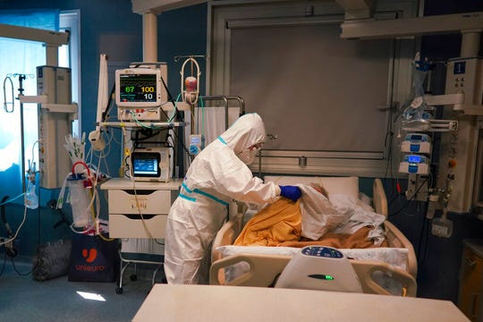 Medical staff tends to a patient in the ICU unit of Rome's San Filippo Neri Hospital's Covid department, in Rome, Thursday.