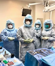 Dr. Michael Boyd and his surgery team now wear extra personal protective equipment when they do their work in the operating room.