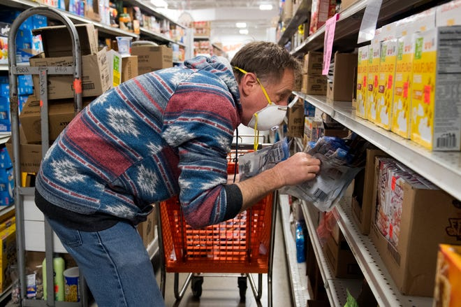 University of Southern Indiana's Assistant Professor of Graphic Design Chuck Armstrong shops for supplies to fill care packages for students and others affected by the COVID-19 pandemic Friday morning, April 10, 2020. Anyone who is in need or wants to donate can visit CoronaCarePackage.org