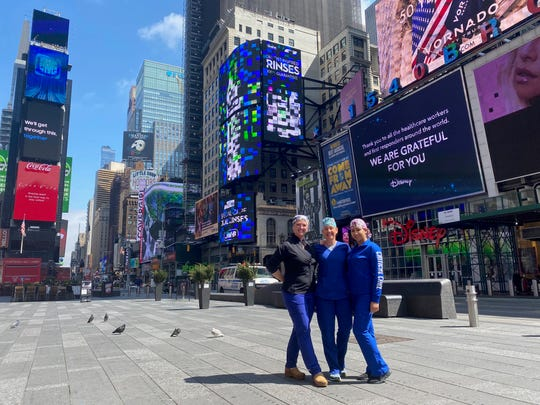 Three Lee County nurses have deployed to New York City to help the city in their fight against COVID-19. From left to right, Gina Willaford, Jackie Lemm and Jennifer Concepcion pose in Times Square, which has been empty as a result of social distancing and stay at home orders.