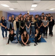 A group of students from Cape Coral High School gathered for a photo on the last day of school before spring break. They wore black and pins supporting their cause to keep block scheduling.