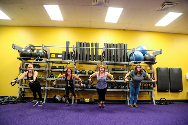 Right to Left: Ashley Sparks, a club manager,  Kristy Woodley, members experience manager, Kristen Gustafson, personal trainer, and Janine Rhodes, a club manager, continued to work for their members while the gym is closed because of the coronavirus. Their employer still payid them and the ladies gave online classes daily for their clients.