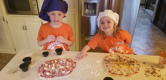 Elliot and Avery Vanden Heuvel get to be chefs for a night at the Vanden Heuvel home. Pizza kits like those from Copper State Brewing answer's the what's for dinner question and double as a family activity.