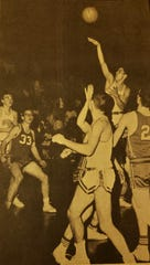 Don Wetzel, Sr., launches a shot over everybody on the court during a 1966 game against the Valier Panthers. Also pictured are Cut Bank teammates Ken Larson (far left, No. 50) and Rob Quist (center front in white).