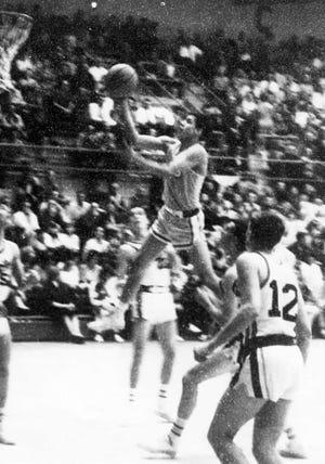 Former Cut Bank star point guard Don Wetzel, Sr., floats through the air toward the hoop.