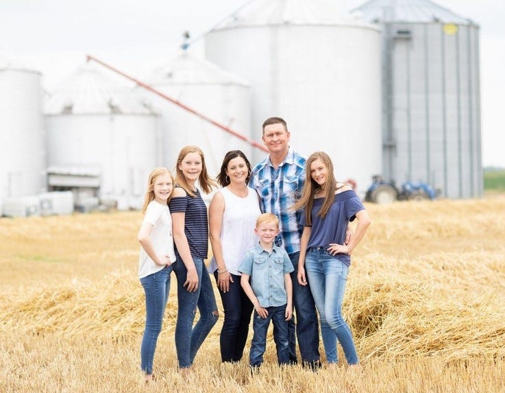 Brian Rexing and his family stand on their farm, New Generation Dairy in Owensville, Ind.