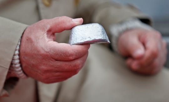 Kurt Koehler holds a pod of aluminum alloy, that by adding water it causes it to react and become hydrogen. The hydrogen is used to fuel the engine.