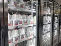 Milk stocks the refrigerators at an Indianapolis grocery store. Previous limits that had been placed on the amounts of milk that customers could buy, in response to panic-buying, are being removed.