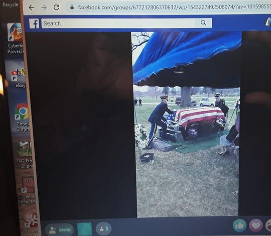 This photo shows the live stream through Facebook of the military graveside rites for World War II veteran Kenneth Adams, 93, of Iowa City which were held Wednesday in Des Moines. Local funeral directors are turning more to this kind of technology during isolation and social distancing to allow friends and family a chance to witness services for their loved ones.