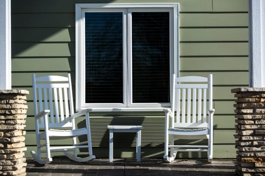 Empty rocking chairs are seen, Friday, April 10, 2020, at Gay & Ciha Funeral Home in Iowa City, Iowa.