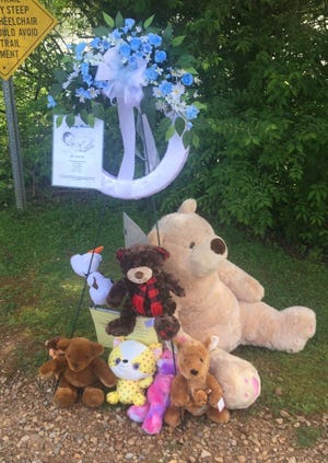 A makeshift memorial stands along the Melton Lake Greenway in Oak Ridge near the site where the body of an unidentified newborn boy, deemed 'baby Wyatt' by authorities, was found March 26, 2020.