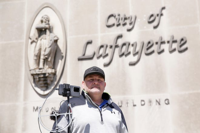 Bryan Wilkins stands outside the Lafayette Municipal Building after being cited for violation of Gov. Eric Holcomb's stay-at-home order, Friday, April 10, 2020 in Lafayette.