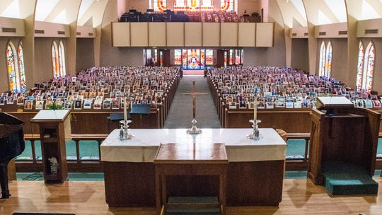 Instead of gathering Sunday for Easter service, photos of members of the congregation sit on pews at Asbury Methodist Church. Friday, April 10, 2020.