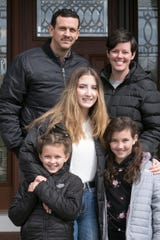 Howell High School foreign exchange student Benedetta Cocciardo from Italy, center, poses with host family Fabrizio and Courtney Tarara and their two children 8-year-old Addison, left, and Parker, 10, Friday, April 10, 2020 in their Cohoctah Township home.