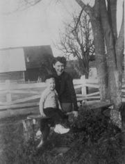 "In this image provided by the McConnell Center at the University of Louisville, Mitch McConnell sits with his mother Julia ""Dean"" McConnell on a bench in this image from the mid 1940's in Five Points, Ala.. As the coronavirus pandemic unfolds, Senate Majority Leader Mitch McConnell flashes back to an earlier crisis that gripped the nation, and his own life, when he was a boy. He was struck with polio."