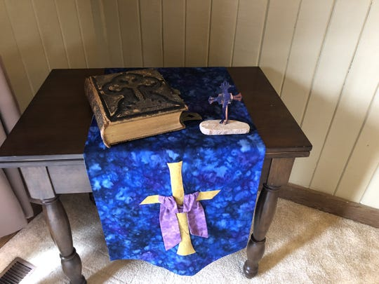 Rev. Betsy Aho of Haslett Community Church created an at-home altar and recommended that others make one too while worshiping during Easter.
