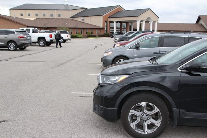 Instead of people filling pews, vehicles filled parking spaces for a drive-in Good Friday service at Dayspring Wesleyan Church in Marion. Due to state orders prohibiting large gatherings during the coronavirus pandemic, the church leaders decided to offer an alternative for their members. The church conducted two Good Friday drive-in services that were also livestreamed on Facebook. Dayspring Wesleyan planned to host three drive-in services on Easter Sunday.