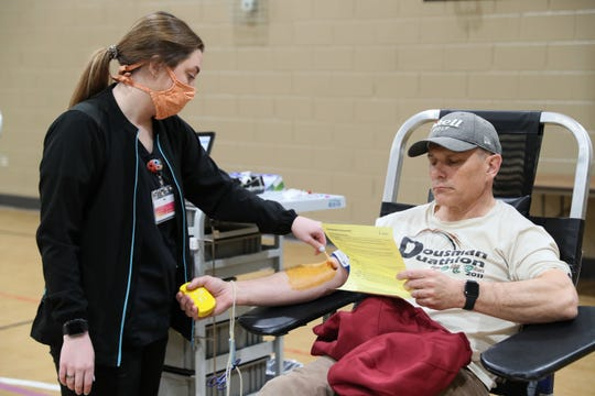 Brooke Smith, left, of Versiti Blood Center of Wisconsin prepares to draw a blood donation from Scott Margis of Oconomowoc. Fox River Christian Church in Waukesha hosted a blood drive on Good Friday conducted by a team from Versiti on Friday, April 10, 2020.