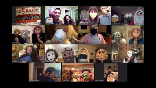 Ruth Lebed and her son Lex Rofeberg, top row, organized a virtual Seder this year and sent local participants paper masks as well as meals and guidebooks. In a screengrab of the celebration, the group poses with their masks of choice.