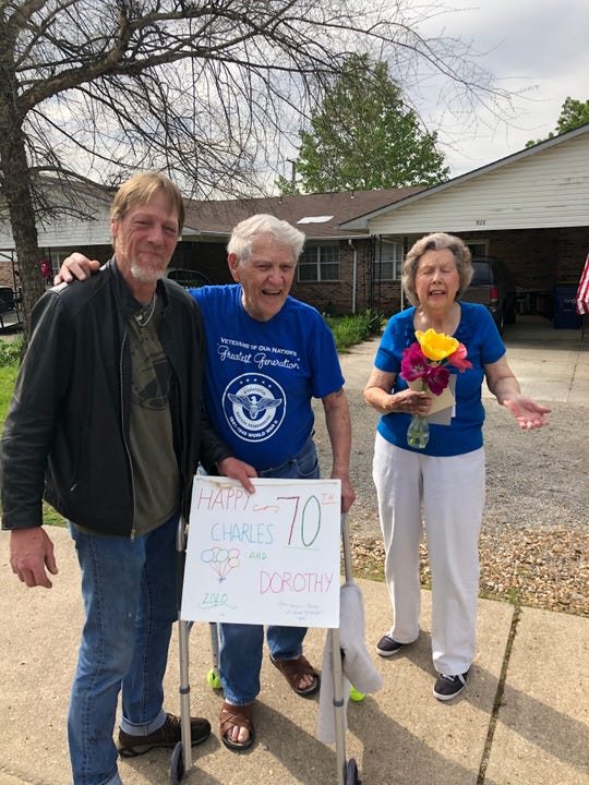A group of 40 automobiles paraded past the home of Charlie and Dorothy Rhea on April 8 to celebrate the couple's 70th anniversary. The couple's son, Jeff, joined his parents on the sidewalk in front of his parent's house to watch the procession.