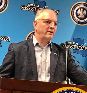Louisiana Governor John Bel Edwards conducts a press conference on April 9, 2010.