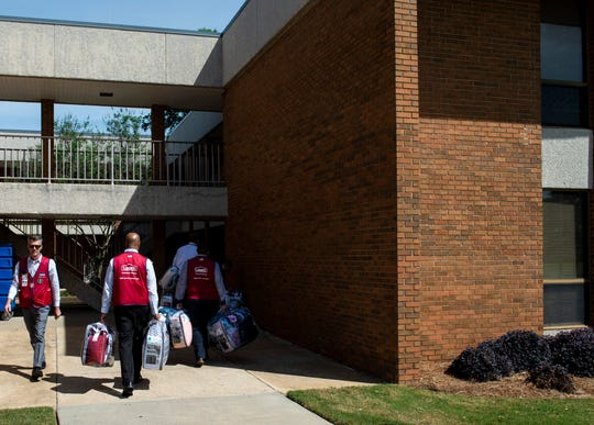 Lowe's employees unload bedding and supplies for dorms at Auburn University Montgomery in Montgomery, Ala., on Friday, April 10, 2020. AUM announced they would open a dorm to healthcare workers afraid of spreading coronavirus.