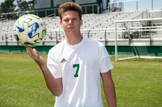 Holtville's Miles Broom poses for a portrait at Holtville High School in Deatsville, Ala., on Friday, April 10, 2020.