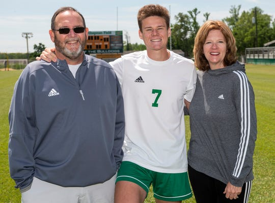 Holtville's Miles Broom poses for a portrait with his parents Robert and Jean Broom at Holtville High School in Deatsville, Ala., on Friday, April 10, 2020.