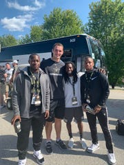From left to right, Shoka Griffin (Muncie Central), Riley Neal (Yorktown, Ball State, Vanderbilt), former Ball State football player Jamill Smith Sr. and MiLon McCowan (Yorktown) gather at the football game between Purdue University and Vanberbilt University on Sept. 7, 2019. Smith trains area athletes.