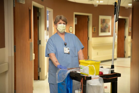 Housekeeper Tammy Moistner works to keep the emergency department clean.